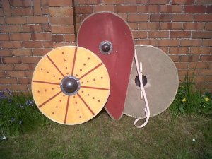 Front and back of a round shield, and a kite shield